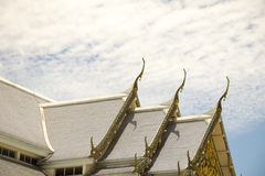 Serpent sculpture of temple roof in Thailand. Stock Photo
