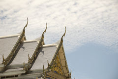 Serpent sculpture of temple roof in Thailand. Royalty Free Stock Photography
