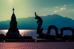 Serpent statue and pagoda at riverside Royalty Free Stock Photography