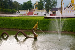 Serpent. Statue was spraying water out of the mouth in the river royalty free stock photos