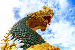 Serpent. Statues of mythical creatures in a Buddhist temple in Thailand Stock Images