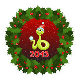 The serpent symbol 2013 and Christmas wreath Stock Photography