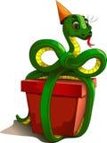 Serpente com um presente Fotos de Stock Royalty Free