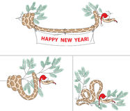 Serpente con il cappello e l'abete rosso di natale Fotografie Stock Libere da Diritti