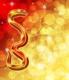Serpente dourada chinesa do ano novo com fundo do borrão
