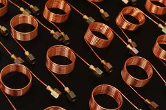 Copper tube coils. Serpentine copper tube coils for industries stock photo