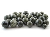 Serpentine gem stone beads on white background Royalty Free Stock Photography