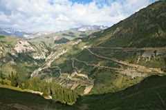 Serpentine highway in Tian Shan mountains Royalty Free Stock Image