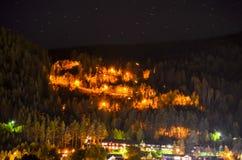Serpentine mountain road illuminating night light Royalty Free Stock Images