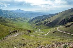 Serpentine mountain road in Kyrgyzstan Royalty Free Stock Photo