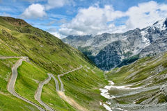 Serpentine road in Alps Stock Images