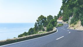 Serpentine road and amazing view of sea and mountain landscape in a sunny day on tropical island. Road adventure trip on. The Canary Islands.Wide stock photography