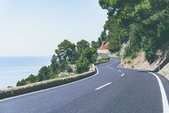 Serpentine road and amazing view of sea and mountain landscape in a sunny day on tropical island. Road adventure trip on. The Canary Islands stock images