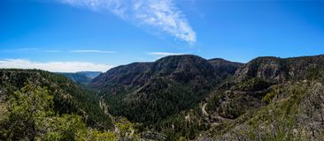 Serpentine road in Arizona mountains. Road throught green mountains in  Arizona, USA Stock Photos
