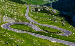Serpentine road in Fagarasan mountains. Lovely transportation background. Popular tourist destination of Romania Stock Images