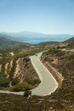 Serpentine road on island Crete, Greece Stock Images