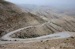 Serpentine road in Judean desert near St. George Orthodox Monastery ,Israel, Middle East Royalty Free Stock Photography