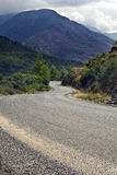 Serpentine road in mountains. In cloudy weather Stock Images
