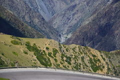 Serpentine road in the mountains. Of Kyrgyzstan Royalty Free Stock Image