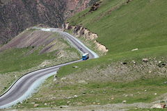 Serpentine road in the mountains. Of Kyrgyzstan Royalty Free Stock Photo