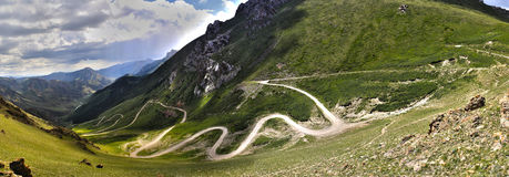 Serpentine road in the mountains. Panorama of the serpentine road in the mountains, son-kul, naryn region, kyrgyzstan Royalty Free Stock Images