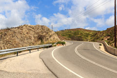 Serpentine road in the mountains in Rhodes Royalty Free Stock Photos