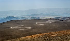 Serpentine road to the top of Mount Etna volcano Stock Photo