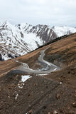 Serpentine. A serpentine's curve in the mountains background Royalty Free Stock Photography