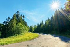 Serpentine uphill through country forest. Beautiful scenery on a bright summer day. explore back country - travel by car concept. transportation background stock image