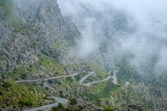 Serpentines in the mountains. Mountain view. Road and transport Stock Photos