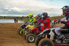 Athletes at the start. SERPUKHOV, RUSSIA - OCTOBER 7, 2017:  Athletes at the start, Class ATV, in the 4 stage  MX series, the Red Wings Cup 2017 super country Royalty Free Stock Images