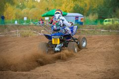 Sharp acceleration. SERPUKHOV, RUSSIA - OCTOBER 7, 2017: Kryukova Ekaterina 777, Class ATV, in the 4 stage MX series, the Red Wings Cup 2017 super country-cross stock photos