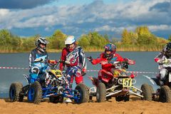 Last preparations. SERPUKHOV, RUSSIA - OCTOBER 7, 2017:  Before the race, Class ATV, in the 4 stage  MX series, the Red Wings Cup 2017 super country-cross, Moto Royalty Free Stock Photography
