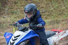 Sportsman. SERPUKHOV, RUSSIA - OCTOBER 7, 2017: Volostnykh Boris 24,  Class ATV-JUNIORS, in the 4 stage  MX series, the Red Wings Cup 2017 super country-cross Royalty Free Stock Photography
