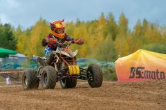 Zolin Nikita 11. SERPUKHOV, RUSSIA - OCTOBER 7, 2017: Zolin Nikita 11,  Class ATV-JUNIORS, in the 4 stage  MX series, the Red Wings Cup 2017 super country-cross Stock Photos