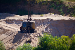 SERPUKHOV, RUSSIA - 23.08.2015: sand career with a worker and an Stock Photography