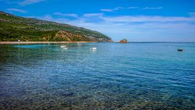Serra da Arrabida beaches and water landscape for relaxing holiday at Setubal, Portugal. Calm water, beach, sun and mountains at Serra da Arrabida, Setubal stock image