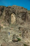Image of Our Lady of the Good Star carved in cliff and man. Serra da Estrela, Portugal - July 12, 2018. Image of Our Lady of the Good Star carved in cliff and royalty free stock photos