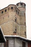 Serralunga Castle: fortified walls and tower. Color image. Serralunga, Italy - February 28, 2018: detail of the fortified walls of the Serralunga Castle Cuneo stock photo