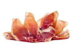 Serrano ham. Closeup of a some slices of spanish serrano ham on a white background Royalty Free Stock Image
