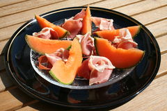 Serrano ham and Cantaloupe melon. Appetizer with Spanish Serrano  ham and Cantaloupe melon on glass plate Stock Photography
