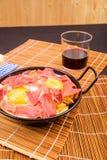 Serrano ham with eggs. Small tapa sized casserole with a serving of serrano ham with eggs Royalty Free Stock Photography