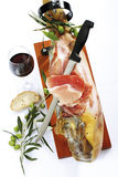 Serrano ham in holder with red wine and olives, elevated view Royalty Free Stock Images