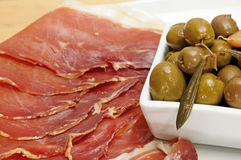 Serrano ham and olives Royalty Free Stock Photos