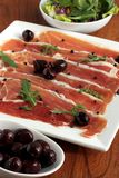 Serrano Ham and Olives Appetizer stock photography