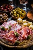 Serrano ham platter with variation of appetizers royalty free stock photo