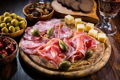 Serrano ham platter with variation of appetizers stock image