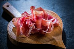 Serrano ham platter with variation of appetizers royalty free stock photos