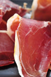 Serrano ham tapas. Closeup of a pile of spanish serrano ham served as tapas Stock Images