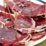 Serrano ham tapas. Closeup of a some spanish serrano ham tapas royalty free stock photos